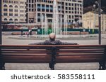 Young Man Sitting On A Bench I...