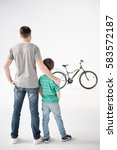 back view of father and son... | Shutterstock . vector #583572187
