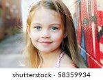 Little Girl In An Urban Setting ...