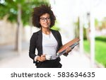 business black woman holding a... | Shutterstock . vector #583634635