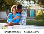 mature couple leaning on back... | Shutterstock . vector #583663399