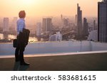businessman is looking at city... | Shutterstock . vector #583681615