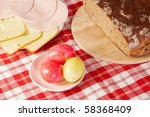 red picnic cloth with hefty food on it - stock photo
