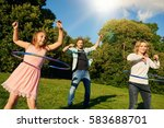 fun loving family playing with... | Shutterstock . vector #583688701