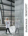 girl in a fur coat walks... | Shutterstock . vector #583692997