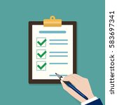 hand filling checklist on... | Shutterstock .eps vector #583697341