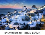 evening time and view of oia... | Shutterstock . vector #583716424