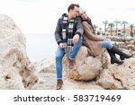 beautiful young couple sitting... | Shutterstock . vector #583719469