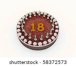 chocolate cake with eighteen candles isolated on white background - stock photo