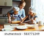happy family in the kitchen.... | Shutterstock . vector #583771249