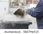 Man Throwing Ashes In A Trash...