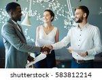 new partners handshaking after...   Shutterstock . vector #583812214