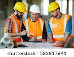 team of construction workers... | Shutterstock . vector #583817641