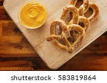 Pretzels and dipping cheese on...