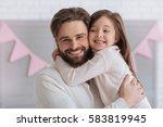 happy sweet girl hugging her... | Shutterstock . vector #583819945