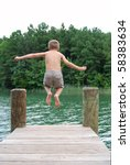 Boy Jumping Off Dock