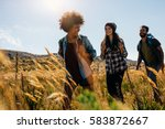 happy group of friends hiking... | Shutterstock . vector #583872667