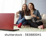 two girl friends sitting on the ... | Shutterstock . vector #583880041