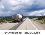 red classic big rig semi truck... | Shutterstock . vector #583903255