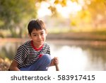 close up asian boy sitting in... | Shutterstock . vector #583917415