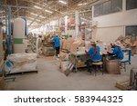 workers working in wood... | Shutterstock . vector #583944325
