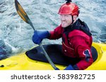 A Kayaker Smiling As He Goes...