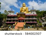 golden temple of dambulla in... | Shutterstock . vector #584002507