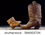 baby cowboy boot and dad cowboy ... | Shutterstock . vector #584003734