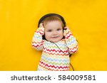 the baby with headphones on a... | Shutterstock . vector #584009581