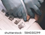 the police officer takes a...   Shutterstock . vector #584030299
