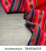 red tablecloth on wooden table... | Shutterstock . vector #584036035