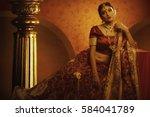 warm look of indian bride | Shutterstock . vector #584041789
