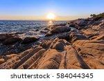 sunrise in orange beach. the... | Shutterstock . vector #584044345