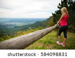woman rests at fence after... | Shutterstock . vector #584098831