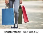legs of female shopaholic with... | Shutterstock . vector #584106517