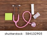 stethoscope with paper note and ... | Shutterstock . vector #584132905