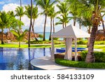tropical beach resort with... | Shutterstock . vector #584133109