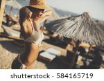 young woman posing on the beach ... | Shutterstock . vector #584165719