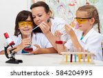 teacher working close with the... | Shutterstock . vector #584204995
