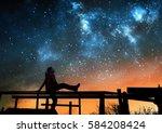 girl watching the stars in... | Shutterstock . vector #584208424