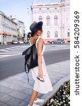 woman in hat from back walking... | Shutterstock . vector #584209369