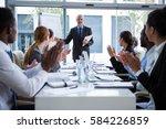 businesspeople applauding on... | Shutterstock . vector #584226859