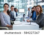 business people looking at a... | Shutterstock . vector #584227267