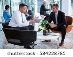 businessmen having discussion... | Shutterstock . vector #584228785