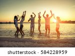 silhouette of group young... | Shutterstock . vector #584228959