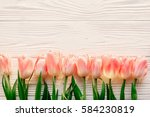 spring flat lay. pink tulips on ... | Shutterstock . vector #584230819