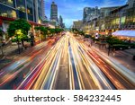 busy street in the city at dusk ... | Shutterstock . vector #584232445