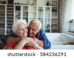 senior couple embracing each... | Shutterstock . vector #584236291