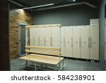 beige cage lockers with a wood... | Shutterstock . vector #584238901