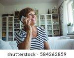 senior woman talking on mobile... | Shutterstock . vector #584262859